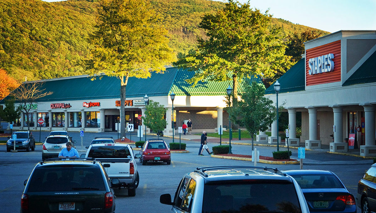 Royal Square Brattleboro VT view of shops from parking lot