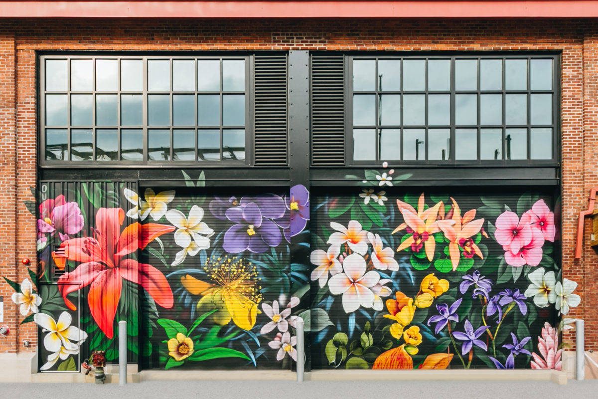 Arsenal Yards Art by Ouizi large scale floral mural installation painted on brick wall